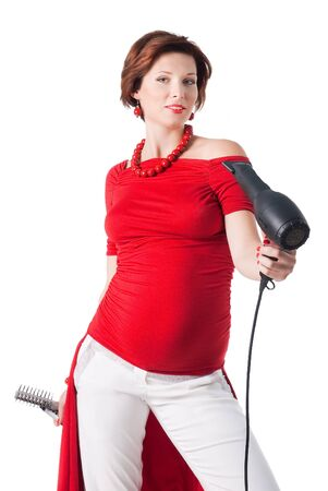 young pregnant woman styling your hair with hairdryer isolated on white background Stock Photo - 12130043
