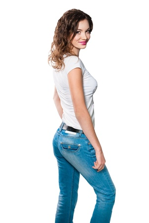 women jeans: Young woman in white shirt and blue jeans isolated on white background