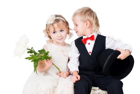 ittle gentlemen and lady romance isolated on white photo