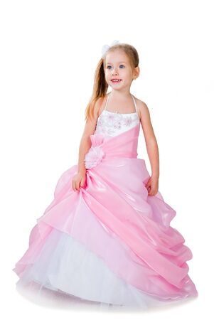 fashionable little girl wearing gorgeous gown isolated on white studio background photo