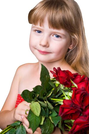 admiring: adorable girl with bouquet of red roses isolated over white background