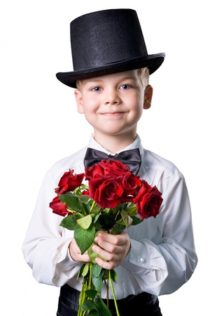 handsome boy wearing classic suit with flowers in hands Stock Photo