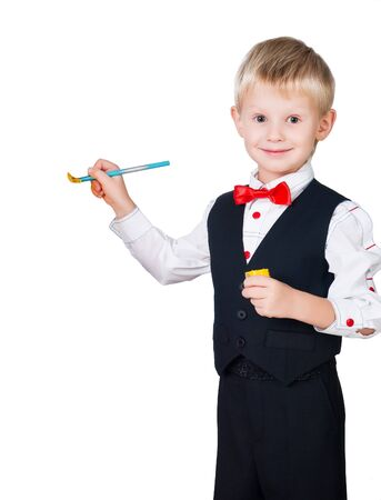 child finger: excited painting boy wearing classic suit isolated on white background