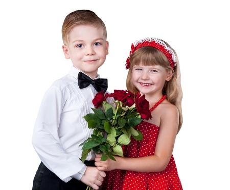 Girl and boy greeting with flowers isolated on white background photo