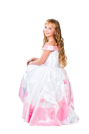 cinderella dress: Cute teen girl with amazing long blond hairs isolated on white background Stock Photo