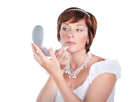 young bride is doing makeup  isolated on white background Stock Photo - 12614107