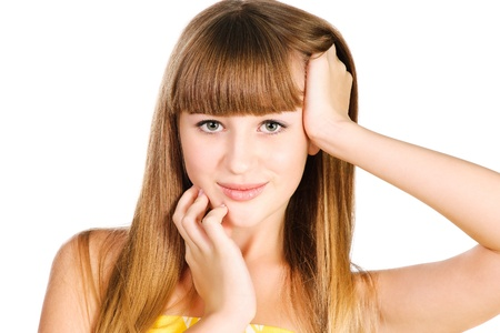 portrait of beautiful teenager girl holding her hairs in hand isolated over white