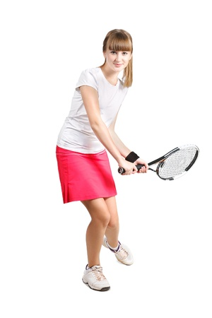 sporty teenage  girl playing tennis  with racket isolated over white background photo