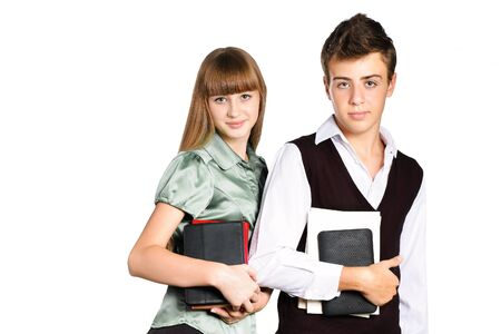 Two students with school books and tablets standing isolated on white background