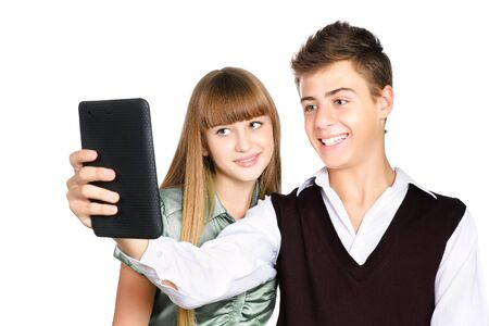 Two teenagers staring into tablet isolated on white background