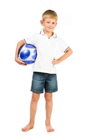 happy boy holding blue soccer ball with scretched legs isolated over white photo