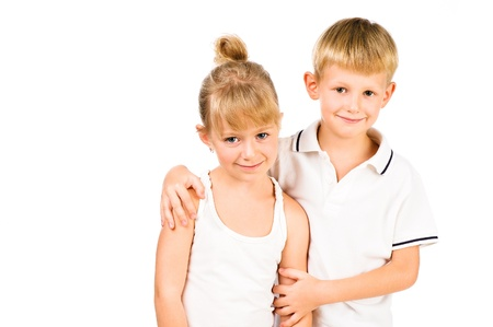 portarit of smiling girl and boy siblings isolated over white