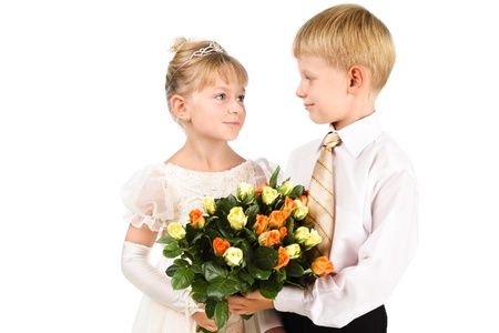 portrait of romantic kids looking at each other with love isolated over white photo