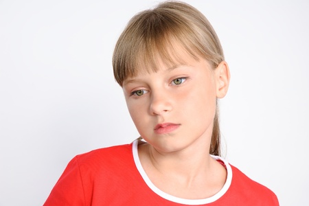 sad preteen girl looking from camera, Teenager problem concept, studio shot photo