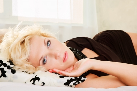 Portrait of  beautiful girl relaxing on the bed