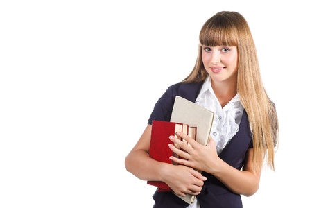 Portrait of a cute young student girl with books isolated on white background