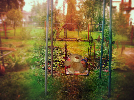 Garden swing with teddy bear and lomography vintage effect photo