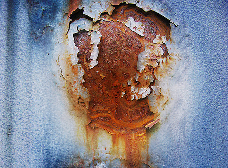 Blue background with detail of corroded metal photo