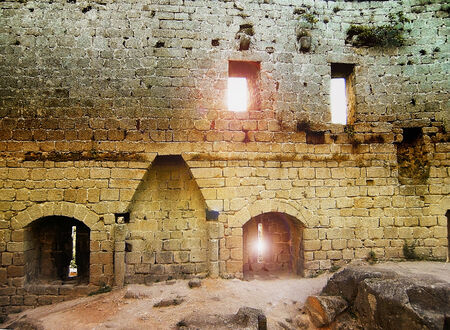 Castle ruins with windows and loopholes photo