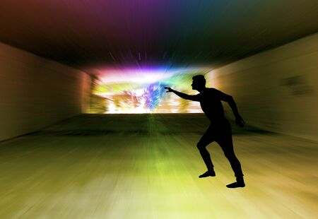Silhouette of a man in a dark tunnel with a spectral light