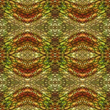 Abstract seamless pattern resembling snake skin. Green, brown, red and orange background with scales, rippling pattern and ovals resembling reptile skin
