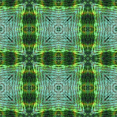 Abstract seamless pattern of squares and scales resembling snake skin. Green, black, orange and yellow kaleidoscopic background with reptile scales