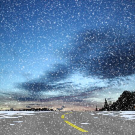 Winter snowy panoramic landscape with road, dark clouds and silhouettes of trees. Highway covered in snow, blue sky with dark clouds Фото со стока