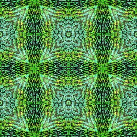 Abstract seamless reflective pattern of scales resembling snake skin. Green, turquoise and yellow background with star-shaped texture