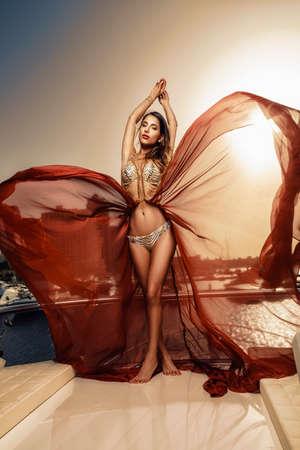 Beautiful mediterranean women posing on the boat Stock Photo