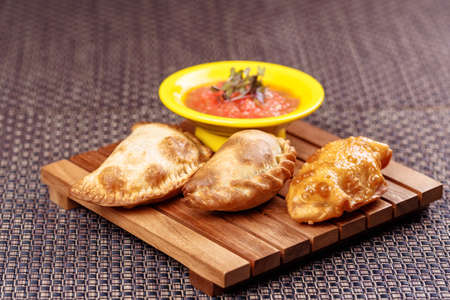 Typical Spanish empanadas with salsa souse.