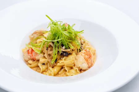 Ballerine pasta with shrimps in white plate