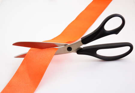Red tape and scissors (file contains clipping path) Stock Photo
