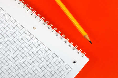 notebook and pencil  ( on a dark red background) Stock Photo - 3007863
