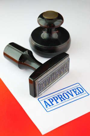 Stamp (on a dark red background ) Standard-Bild