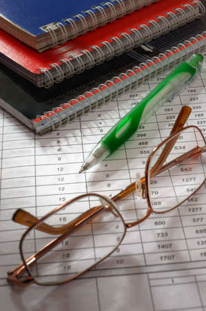 future earnings: Glasses pen and notebooks  Stock Photo