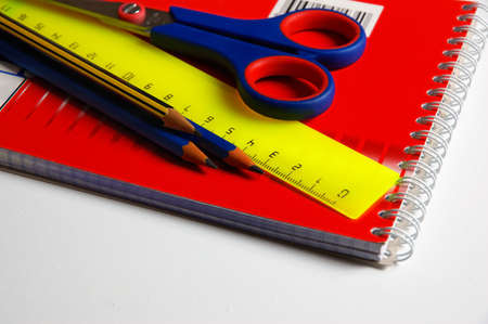 stationery pencil, scissors, notebook and ruler photo