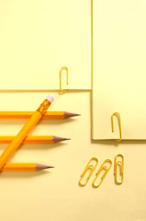 Yellow page and pencil on yellow background with soft shadow Stock Photo - 3881301