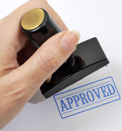 Rubber stamp in a hand  photo