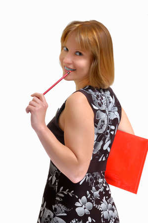 smiling woman with a pencil in hands photo