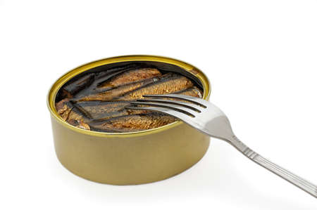 Opened fish can  On a light grey background photo