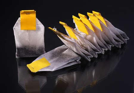 tea bags on a dark grey background