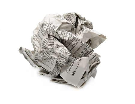 짓 눌린: 신문 공을 흰 배경에 고립 스톡 사진