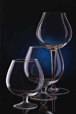 Group of wine glasses on colour a gradient a background photo
