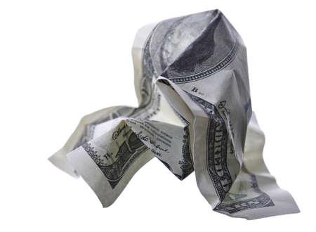 devaluation:  crumpled monetary denomination on a white background