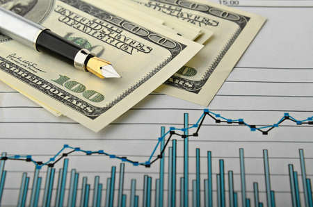 pen and monetary denominations over the financial schedule Stock Photo - 10861765