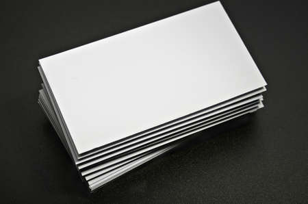 note card: blank business card against a dark background