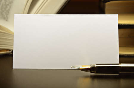 post cards: Business card and fountain pen against a dark desktop Stock Photo