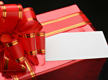 Gift packing by close up against a dark background photo