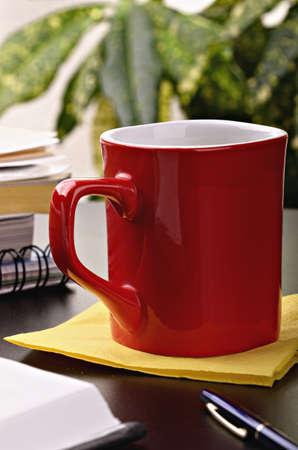 coffee plant: Red coffee mug located on a yellow napkin Stock Photo