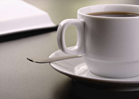 cup of coffee on the dark surface of the table